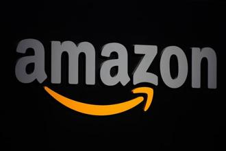 As India bans FDI in online retail, e-commerce firms Amazon and Flipkart operate as marketplace platforms that connect small merchants with buyers. Cloudtail India and WS Retail are the firms' largest marketplaces respectively. Photo: AFP