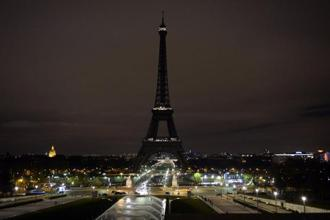 A picture taken on Saturday shows the Eiffel Tower with its lights turned off following the deadly attacks in Paris. Photo: AFP