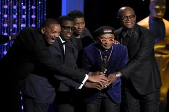 Will Smith, from left, Wesley Snipes, Denzel Washington, SpikeLee, honorary Oscar recipient, and Samuel L. Jackson pose onstage at the Governors Awards at the Dolby Ballroom on Saturday in Los Angeles. Photo: AP