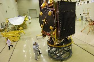 A file photo of engineers from Reshetnev Information Satellite Systems near the AMOS-5 geostationary telecommunications satellite. Photo: Reuters