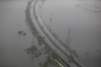 An aerial view shows vehicles moving on roads in a flood-affected area in Chennai on 6 December. Photo: Reuters