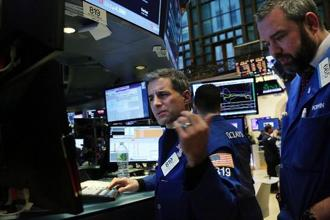 Equities from Europe to Asia tumbled in the wake of the rout in American stocks on Wednesday, while the cost of insuring corporate debt climbed.