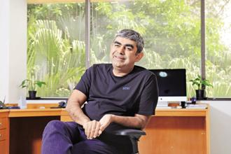 Infosys CEO Vishal Sikka. The IT firm said in the December quarter, its net profit grew 6.6% to Rs3,465 crore from Rs3,250 crore a year earlier. Its revenue grew more than 15% to Rs15,902 crore. Photo: Hemant Mishra/Mint