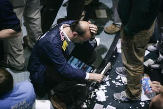 A file photo of a trader on the floor of a US stock market. Photo: Getty Images