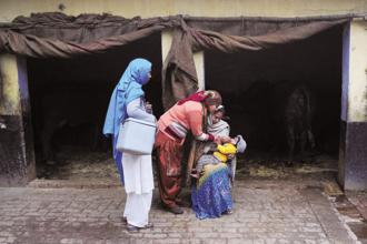 A file photo of a health worker administering polio vaccination to a child in Ghaziabad. According to the National Family Health Survey, 2015-16, at least six out of 10 children received full immunization in 12 of the 15 states and union territories. Photo: AFP