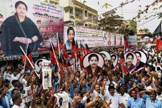 A file photo shows AIADMK supporters cheering Jayalalithaa as she pays tribute to party founder M. G. Ramachandran on his 99th birth anniversary. Photo: AP