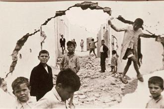 Henri Cartier-Bresson's 1933 image of children playing amid ruins in Seville, Spain. Photo: AFP