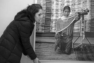 Gauri Gill By Manisha Gera Baswani 2015. Gill is pictured installing a photograph from Balika Mela at the India Art Fair 2015.