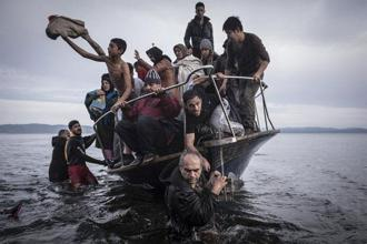Migrants coming from Turkey arrive in the Greek island, Lesbos. Photo: Sergey Ponomarev/The New York Times