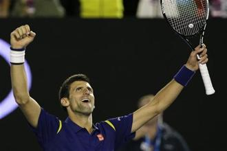 Novak Djokovic celebrates after beating Andy Murray in the men's singles final at the Australian Open on Sunday. Photo: AP