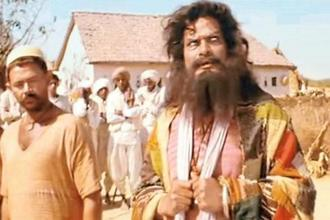 Rajesh Vivek (right) in the film Lagaan.