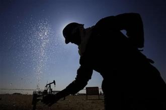 A file photo of a worker working on oil pipelines in the desert oil fields of Bahrain.  For some observers, the Russia-Saudi detente is the first tentative step toward the revival of Opec's appetite for market management. Photo AP