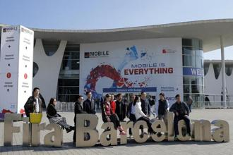 People taking pictures in front of the venue of the Mobile World Congress, the world's largest mobile phone trade show in Barcelona, Spain. Photo: AP