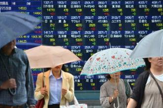 Japan's Nikkei gained 1% largely on the overnight fall in the yen while US stock futures were little changed from late last week. Photo: AFP