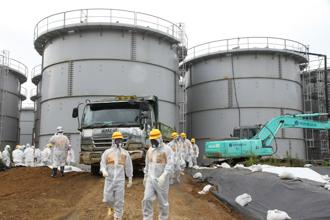 A file photo of nuclear watchdog members including NRA in radiation protection suits inspecting contaminated water tanks at TEPCO Fukushima Dai-ichi nuclear power plant. Photo: AFP/Nuclear Regulation Authority
