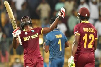 West Indies' Andre Fletcher and Andre Russel celebrate the win over Sri Lanka during the ICC World T20 match between West Indies and Sri Lanka at Chinnaswamy Stadium in Bengaluru on Sunday. Photo: PTI