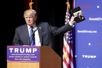 "A file photo of Donald Trump with his book, Trump: The Art of the Deal. Co-author Tony Schwartz had tweeted, ""I wrote The Art of the Deal. Donald Trump read it."" Photo: AP"