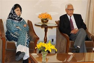 Jammu and Kashmir governor N.N. Vohra (right) in a meeting with PDP president Mehbooba Mufti in Jammu on Saturday. Photo: PTI