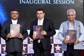 Union Minister Ravi Shankar Prasad (left), filmmaker Ramesh Sippy (right) and Uday Shankar, CEO, Star Network release KMPG Report during the inaugural session of FICCI Frames 2016 in Mumbai on Wednesday. Photo: PTI