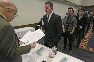 A file photo of employment seekers during a National Career Fairs job fair in Chicago. Photo: AP