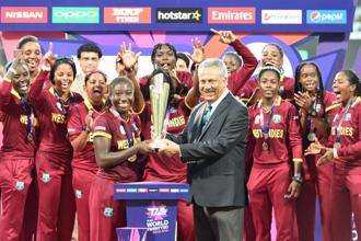 ICC chief Zaheer Abbas presents the trophy to West Indies's Stafanie Taylor after West Indies won the World T20 cricket tournament women's final match between Australia and West Indies at The Eden Gardens Cricket Stadium in Kolkata on Sunday. Photo: AFP