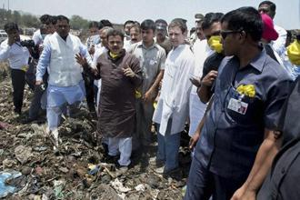 Congress vice-president Rahul Gandhi visiting Deonar dumping ground in Mumbai on Tuesday. Photo: PTI