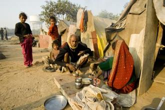 India's poverty rate declined from 45% in 1993-94 to 22% in 2011-12, according to official statistics. Photo: Ramesh Pathania/Mint