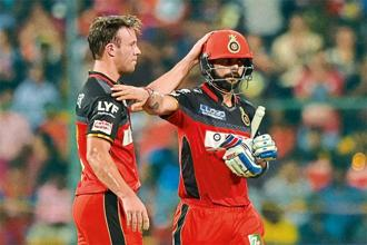 A.B. de Villiers (left) and Virat Kohli. Photo: PTI