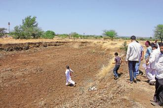Water diviner Datta Maharaj, accompanied by villagers, looks for an aquifer in Marathwada. Photo: Ananda Banerjee/Mint