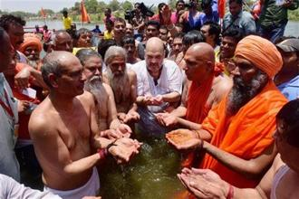 The customary dip was named Samrasta Snan or dip for social harmony with Dalits at Valmiki Ghat. Photo: AP