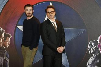 "Actors Chris Evans (left), who plays ""Captain America"" and Robert Downey Jr, who plays ""Iron Man"", pose for photographers at a media event ahead of the release of ""Captain America: Civil War"" in London on 25 April. Photo: Reuters"