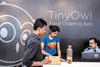 TinyOwl, a pioneering Mumbai-based food-delivery app that raised $23 million from investors including Sequoia Capital, has run through most of its money and will merge with a smaller delivery firm, Runnr. Photo: Bloomberg
