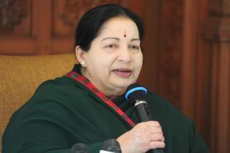 J. Jayalalithaa on Thursday created a history of sorts by becoming the first chief minister to be sworn in for the second consecutive term in the state in nearly three decades. Photo: AFP