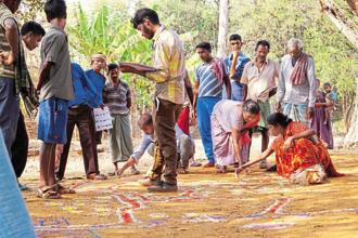 Volunteers and villagers participating in a community mapping exercise to help in the creation of better village development plans.