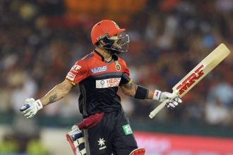 With 919 runs scored from 15 matches, Virat Kohli is already the highest-scoring batsman in a single season in IPL's 9-year history.  Photo: AFP