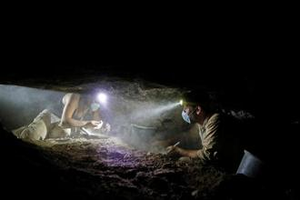 Volunteers with the Israeli Antique Authority work inside the Cave of the Skulls, an excavation site in the Judean Desert near the Dead Sea. Photo: Reuters