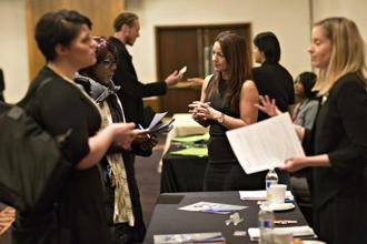 A file photo of people in Chicago at a career fair. Photo: Bloomberg