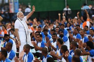Prime Minister Narendra Modi greets Yoga participants on the occasion of the 2nd International Day of Yoga at the Capitol Complex in Chandigarh on Tuesday. Photo: PTI