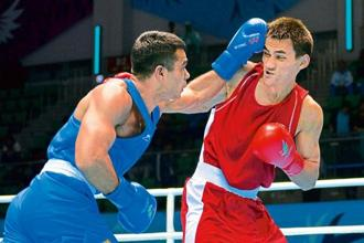 Vikas Krishan Yadav, in blue, at the 2014 Asian Games. Photo: Bay Ismoyo/AFP