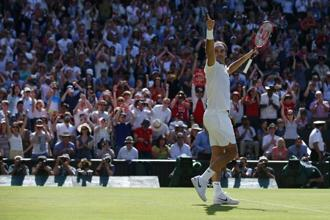 Roger Federer, the oldest man to reach the Wimbledon semi-finals since 1974, celebrates after winning against Marin Cilic. Photo: AFP