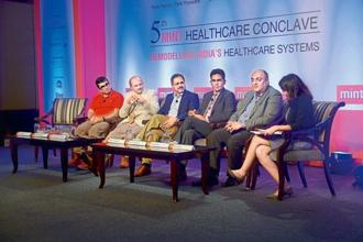 (Left to right) Vishal Gondal, founder and chief executive officer, GOQii; Shrinivas Ranade, chief medical officer, Mahindra and Mahindra; Azfar Hussain, global head-human resources, Zensar Technologies; Rohit Kapoor, senior director and chief growth officer, Max Healthcare; N. Rajaram, country head and general manager-pharmaceuticals, Sanofi India, and Ira Dugal, deputy managing editor, Mint, at the Mint Healthcare Summit in Mumbai. Photographs bt Abhijit Bhatlekar/Mint