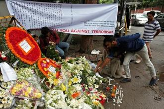 A file photo of people placing flowers at a makeshift memorial to pay tribute to the victims of the terror attack in Dhaka. Photo: Reuters