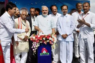 Prime Minister Narendra Modi unveiled Mission Bhagiratha, the Telangana government's bid to provide piped water supply to every household, on Sunday. Photo: PTI