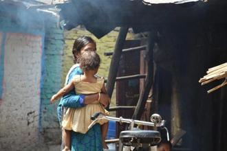 Behind The Smoke: A photograph clicked by a slum child in Sriniwaspuri.