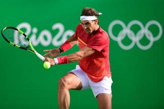 Spain's Rafael Nadal returns the ball to Brazil's Thomaz Bellucci during their men's singles quarter-finals tennis match at the Olympic Tennis Centre of the Rio 2016 Olympic Games in Rio de Janeiro on 12 August 2016.  Photo: AFP