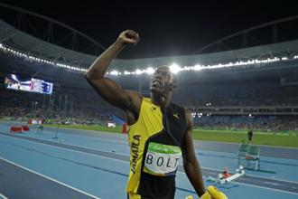 Jamaica's Usain Bolt celebrates after winning the gold medal during the athletics competitions of the 2016 Summer Olympics in Rio de Janeiro, Brazil. Photo: AP