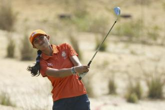 Aditi Ashok hits her approach shot on the second hole during third round women's Olympic golf competition. Photo: Reuters