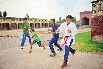 Schoolchildren in Mokhra Khas, Haryana. The sporting culture of Haryana is in full evidence in this village of 10,000-odd residents that considers farming to be its principal occupation. Photo: Pradeep Gaur/Mint