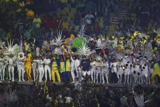 Torrential showers continued unabated but it did not matter to the athletes who sported translucent raincoats with several of them singing, dancing and taking selfies during the nearly three-hour-long closing ceremony. Photo: Reuters