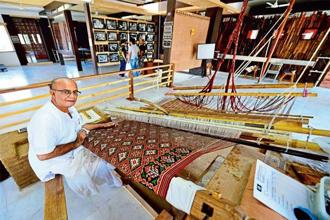 A 2014 photo of Bharat Salvi, one of Patan Patola's senior weavers, at his loom in the only such Patan Patola museum in the world. Photo: Priyanka Parashar/Mint